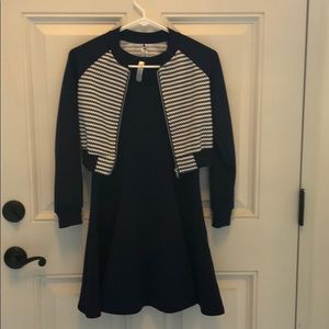 Navy and white dress with cropped jacket.